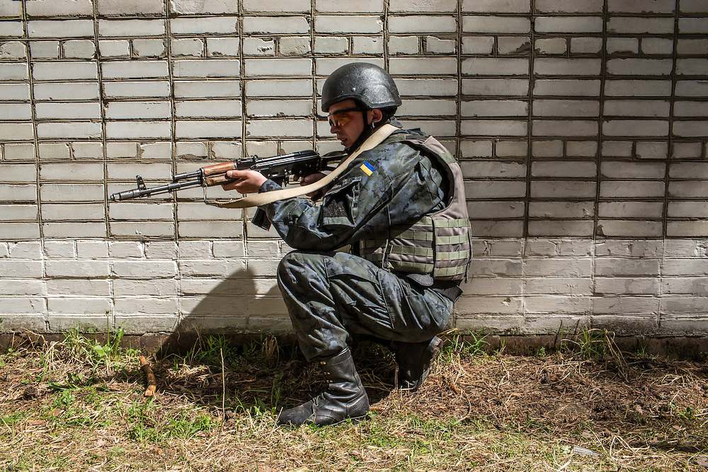 YAVORIV, UKRAINE - APRIL 30, 2015: A Ukrainian soldier participates in a mock house raid, a component of military training directed by the U.S. Army's 173rd Airborne Brigade as part of Operation Fearless Guardian at the Yavoriv training center near Yavoriv, Ukraine. Around 300 American soldiers are training an equivalent number of Ukrainians during each of three eight-week programs to improve their ability to combat Russian-backed rebels in the country's east. CREDIT: Brendan Hoffman for The New York Times