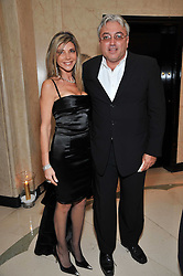 ROBERT TCHENGUIZ and his sister LISA TCHENGUIZ at a dinner in honour of Dennis Basso in celebration of his new boutique in Harrods held at Claridge's, Brook Street, London on 15th October 2009.