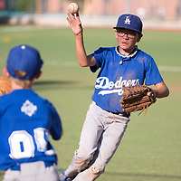 063015      Cayla Nimmo<br /> <br /> Dodgers player Bias Saucedo (1) throws the ball to first baseman Brayden Balok (4) at the Tuesday night game against the Nationals held at Ford Canyon Park.