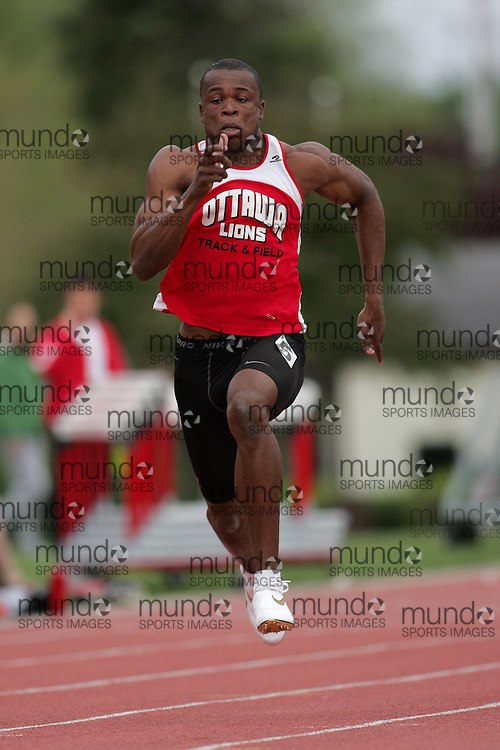 (Canton, USA---07 May 2010) Oluseyi Smith of the Ottawa Lions runs to victory and a stadium record of 10.48 seconds in the 100m at the St Lawrence University Saints twilight track and field competition. Sean Burges / Mundo Sport Images, 2010. www.mundosportimages.com