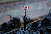 Tokyo, April 10 2014 - Model of a warship with former Japanese flag on display at the Yushukan, Yasukuni's war museum.