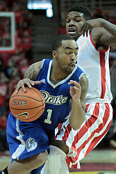 01 February 2014:  Karl Madison cuts past Bobby Hunter during an NCAA Missouri Valley Conference (MVC) mens basketball game between the Drake Bulldogs and the Illinois State Redbirds  in Redbird Arena, Normal IL.