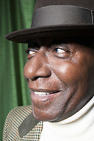 Senior Man Wearing a Hat in studio close up