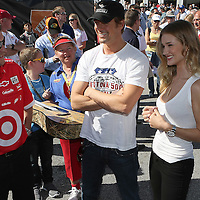 Acotr Josh Duhamel (center) and Rosie Huntington-Whiteley speak with crew members in the Sprint Cup garage area prior to the Daytona 500 at Daytona International Speedway.at Daytona International Speedway on February 20, 2011 in Daytona Beach, Florida. (AP Photo/Alex Menendez)