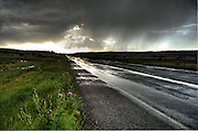A fast moving thunderstorm left the roads wet east of Wagon Wheel, New Mexico.
