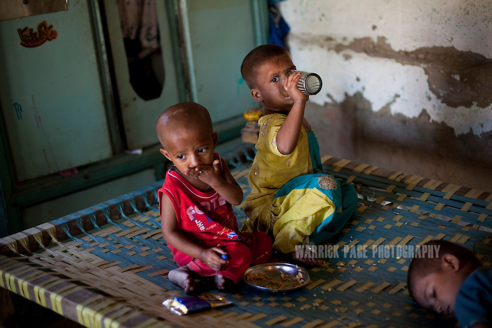 Mohammad Ali, 2, (L) eats with his siblings in their home, on October 13, 2011, in Manzoorabad, Pakistan. Mohammad was discharged from the nutrition stabilisation centre in Jamsharoo, after being admitted two months ago with severe malnutrition brought on by TB and pneumonia. Extreme poverty, poor diet and health, exposure to disease, and inadequate sanitation and hygiene annually produce alarming levels of malnutrition amongst children, but the floods of 2010 and 2011 have increasingly endangered an already vulnerable population. Child malnutrition has breached emergency levels in Pakistan - particularly Sindh province - after monsoon floods devastated the country's poorest region for a second year. Malnourishment It is the single biggest contributor to under-five mortality, increasing the risk of infections and slowing recovery from illness. It stuns both mental and physical growth and their future capacity, sapping the next generation's ability to meet the demands of a country already facing an unstable future. According to UN reports, hundreds of thousands of children in Pakistan suffer from severe-acute-malnutrition, with 15.1% of children experiencing acute malnourishment. The Economist recently reported that 44% of children in Pakistan suffer from varying degrees of malnutrition. (Photo by Warrick Page)
