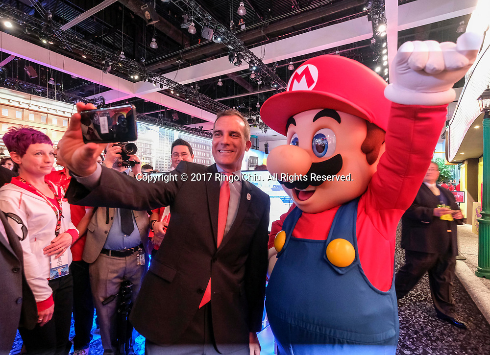 Los Angeles City Mayor Eric Garretti, left, takes selfie pictures with Nintendo&rsquo;s iconic character Mario in the 2017 Electronic Entertainment Expo (E3) at the Los Angeles Convention Center on June 13, 2017.(Photo by Ringo Chiu)<br /> <br /> Usage Notes: This content is intended for editorial use only. For other uses, additional clearances may be required.