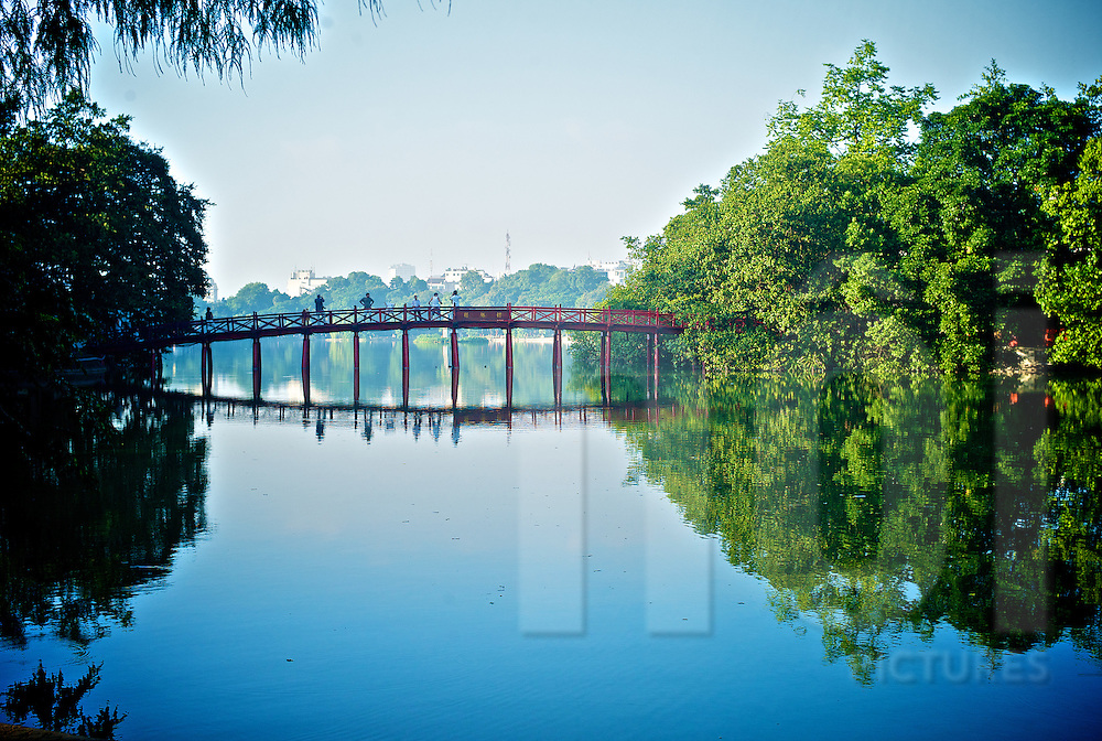 The Huc Bridge landmark stretching over Hoan Kiem lake to Ngoc Son temple on Jade Island, Hanoi, Vietnam, Southeast Asia