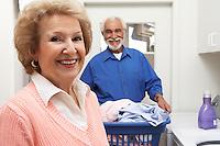 Senior couple with laundry