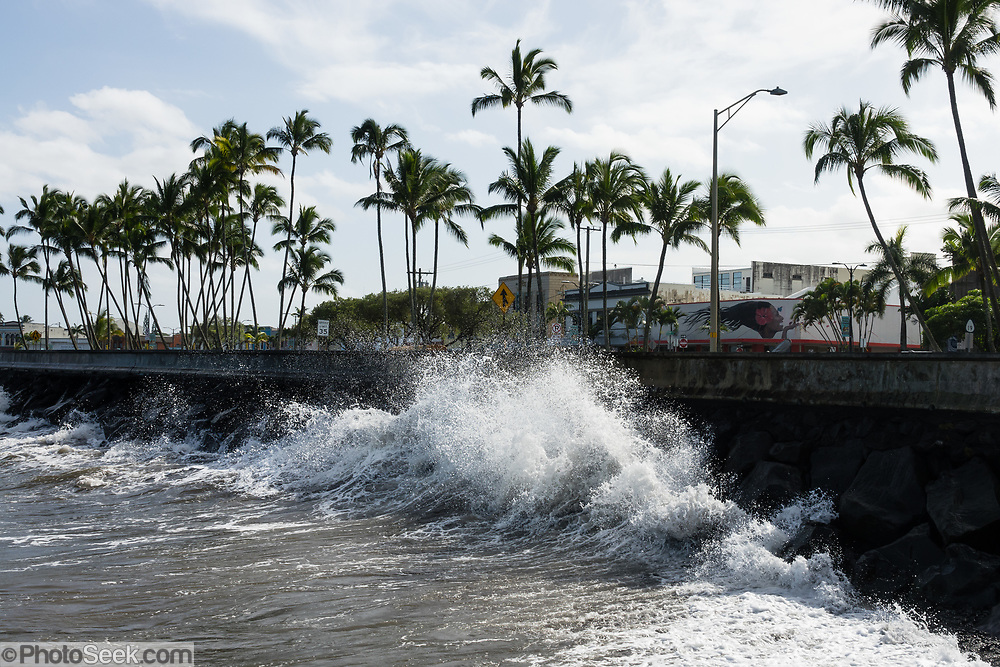 Waves crash along Hilo Bay, in downtown Hilo, on the Big Island, Hawaii, USA.