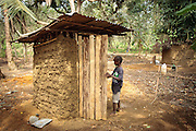 A boy walks up to a home latrine in the village of Kawejah, Grand Cape Mount county, Liberia on Friday April 6, 2012. As part of the UNICEF sponsored CLTS programme, communities learn to put in practice good hygiene and sanitation practices.