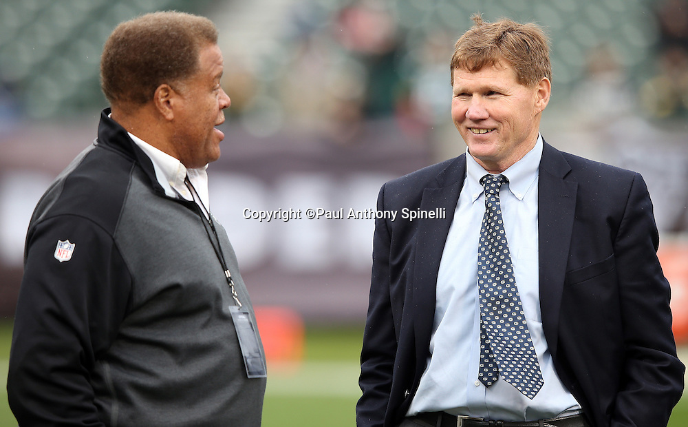 (L-R) Oakland Raiders General Manager Reggie McKenzie talks to Green Bay Packers President and CEO Mark Murphy before the 2015 week 15 regular season NFL football game against the Oakland Raiders on Sunday, Dec. 20, 2015 in Oakland, Calif. The Packers won the game 30-20. (©Paul Anthony Spinelli)