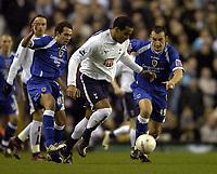 Photo: Olly Greenwood.<br />Tottenham Hotspur v Cardiff City. The FA Cup. 17/01/2007. Tottenham's Tom Huddlestone gets past Cardiff's Michael Chopra and Riccardo Scimeca