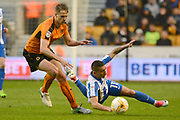 Wolverhampton Wanderers midfielder Dave Edwards (4) fouls Brighton & Hove Albion winger Anthony Knockaert (11) 0-1 during the EFL Sky Bet Championship match between Wolverhampton Wanderers and Brighton and Hove Albion at Molineux, Wolverhampton, England on 14 April 2017. Photo by Alan Franklin.