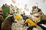 Individual farmers load their cotton harvest onto trucks to be sold collectively. Prior to loading, each farmer's harvest is weighed for a fair share of the profit. Despite the positive cooperation between Burkina Faso's two million cotton farmers, subsidised production in the west forces their income below a dollar a day. <br /> <br /> Southern Burkina Faso