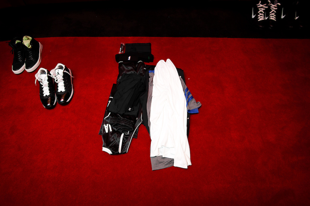 MIAMI, FL -- January 29, 2012 -- Miami forward LeBron James lays out his clothes on the floor in a pre-game ritual in the Heat's locker room prior to their 97-93 win over the Chicago Bulls at American Airlines Arena in Miami, Fla., on Sunday, January 29, 2012.  (Chip Litherland for ESPN the Magazine)