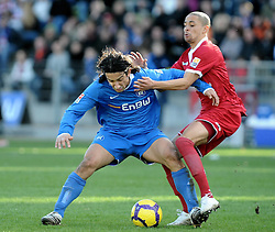 27.02.2010, Wildparkstadion, Karlsruhe, GER, 2. FBL, Karlsruher SC vs 1.FC Kaiserslautern, im Bild Gaetan Krebs (Karlsruhe FRA #21) im Zweikampf mit Sidney Sam (Kaiserslauern #8) EXPA Pictures © 2010, PhotoCredit: EXPA/ nph/  Roth / for Slovenia SPORTIDA PHOTO AGENCY.