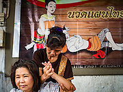 27 AUGUST 2016 - BANGKOK, THAILAND: People get traditional Thai massages during a lunch for residents of the Pom Mahakan slum in Bangkok. The Pom Mahakan community is known for fireworks, fighting cocks and bird cages. Mahakan Fort was built in 1783 during the reign of Siamese King Rama I. It was one of 14 fortresses designed to protect Bangkok from foreign invaders. Only two of the forts are still standing, the others have been torn down. A community developed in the fort when people started building houses and moving into it during the reign of King Rama V (1868-1910). The land was expropriated by Bangkok city government in 1992, but the people living in the fort refused to move. In 2004 courts ruled against the residents and said the city could evict them. The city vowed to start the evictions on Sept 3, 2016, but this week Thai Prime Minister Gen. Prayuth Chan-O-Cha, sided with the residents of the fort and said they should be allowed to stay. Residents are hopeful that the city will accede to the wishes of the Prime Minister and let them stay.       PHOTO BY JACK KURTZ