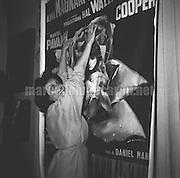 """Rome,1956. Actress Anna Magnani in front of the poster of the movie """"The Rose Tattoo"""" / Roma, 1956. L'attrice Anna Magnani davanti al manifesto del film """"La rosa tatuata"""" / - Marcello Mencarini Historical Archives"""