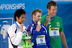 Second placed Junya Koga of Japan, Winner Liam Tancock of Great Britain and third placed Gerhard Zandberg of Republic South Africa  at the victory ceremony after the Men's 50m Backstroke Final during the 13th FINA World Championships Roma 2009, on August 2, 2009, at the Stadio del Nuoto,  in Foro Italico, Rome, Italy. (Photo by Vid Ponikvar / Sportida)