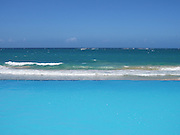 Infinity edge pool with a view of ocean waves and the horizon in Condado near San Juan, Puerto Rico. Tranquility!
