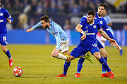 Manchester City midfielder Bernardo Silva (20) looks to go past FC Schalke 04 midfielder Daniel Caliguri and goes down during the Champions League round of 16 leg 1 of 2 match between FC Schalke 04 and Manchester City at Veltins Arena, Gelsenkirchen, Germany on 20 February 2019.