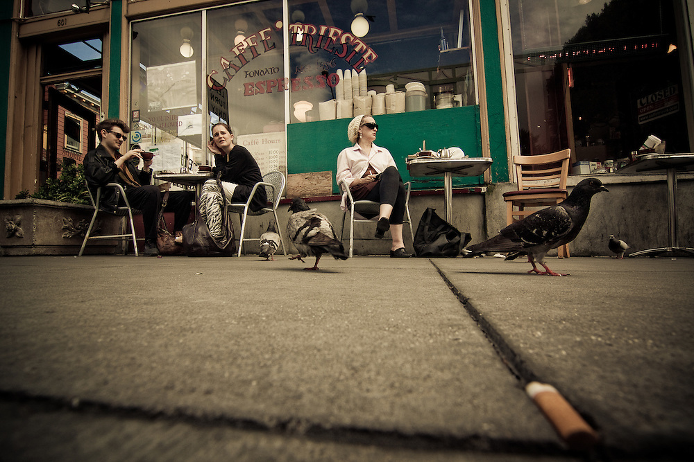 Pigeons and patrons dine at Caffe Trieste, an espresso cafe in north beach, San Francisco, California.