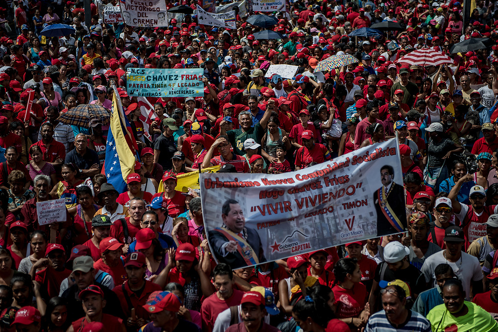 CARACAS, VENEZUELA - APRIL 19, 2017:  Government supporters also held a march today.  Hundreds of protesters showed up in La Vega slum, many more than were present supporting the opposition.  Several people present said they were obligated by the government to attend in order to keep their jobs and access to government subsidized food and housing.  PHOTO: Meridith Kohut