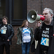 Sean Clerkin (R) of the Scottish Resistance speaking at a demo in Cadogan Street, Glasgow. With fellow members James Scott (L) and Alicia MacKenzie (C). Picture Robert Perry 29th Jan 2016<br /> <br /> Must credit photo to Robert Perry<br /> FEE PAYABLE FOR REPRO USE<br /> FEE PAYABLE FOR ALL INTERNET USE<br /> www.robertperry.co.uk<br /> NB -This image is not to be distributed without the prior consent of the copyright holder.<br /> in using this image you agree to abide by terms and conditions as stated in this caption.<br /> All monies payable to Robert Perry<br /> <br /> (PLEASE DO NOT REMOVE THIS CAPTION)<br /> This image is intended for Editorial use (e.g. news). Any commercial or promotional use requires additional clearance. <br /> Copyright 2014 All rights protected.<br /> first use only<br /> contact details<br /> Robert Perry     <br /> 07702 631 477<br /> robertperryphotos@gmail.com<br /> no internet usage without prior consent.         <br /> Robert Perry reserves the right to pursue unauthorised use of this image . If you violate my intellectual property you may be liable for  damages, loss of income, and profits you derive from the use of this image.