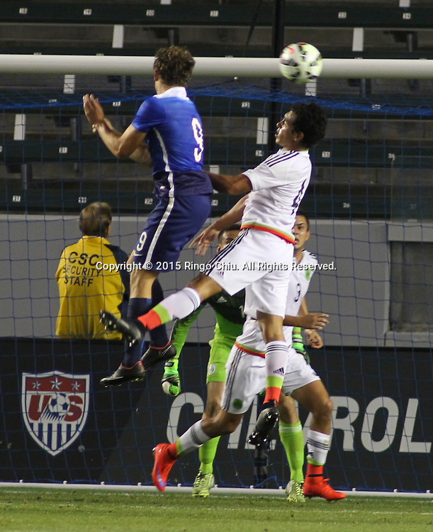 United States' Jordan Morris #9 actions against Mexico's Luis Guzm‡n #4 during a men's national team international friendly match, April 22, 2015, at StubHub Center in Carson, California. United States won 3-0. (Photo by Ringo Chiu/PHOTOFORMULA.com)