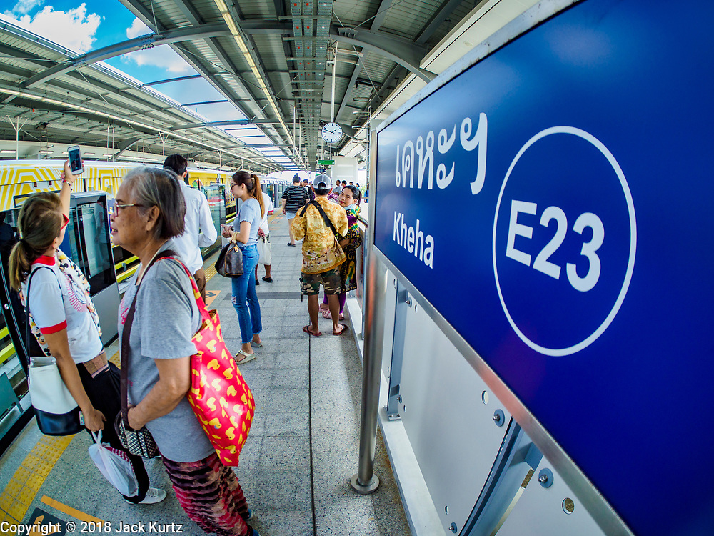 06 DECEMBER 2018 - SAMUT PRAKAN, THAILAND:  Passengers wait for a train in the Kheha station on the first day of service on BTS Skytrain east extension. The 12.6 kilometer (7.8 miles) east extension of the Sukhumvit Line of the Bangkok BTS Skytrain goes into Samut Prakan, a town east of Bangkok.  The system is now 51 kilometers long (32 miles), including the 12.6 kilometer extension that opened December 06. About 900,000 people per day use the BTS.    PHOTO BY JACK KURTZ