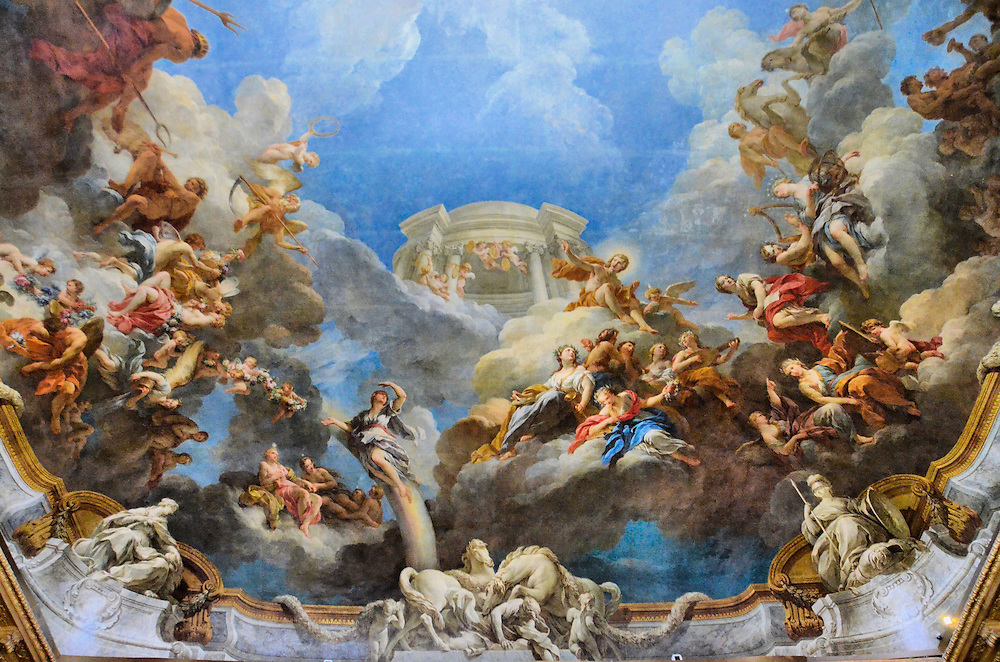 Ch&acirc;teau de Versailles Hercules Room Ceiling in Versailles, France<br /> This opulent ceiling is called Apotheosis of Hercules and it was painted by Fran&ccedil;ois de Moyne in 1773-36 in the Ch&acirc;teau de Versailles&rsquo; Hercules Salon (salon d&rsquo;Hercule).  The room was a ballroom during the reign of Louis XV. It is just one beautiful example of the paintings, sculptures, period furniture, and gilded statues that will amaze you as you walk through the palace on a self-guided tour accompanied by a headset.