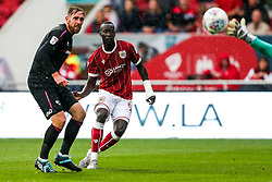 Famara Diedhiou of Bristol City scores a goal to make it 4-1 as Richard Keogh of Derby County challenges - Rogan/JMP - 16/09/2017 - Ashton Gate Stadium - Bristol, England - Bristol City v Derby County - Sky Bet Championship.