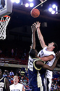 26 November 2005: Monmouth center, Corey Hallett (13) takes a hook shot over ORU sophomore, Yemi Ogunoye in the Monmouth University loss 54-62 to Oral Roberts University at the Great Alaska Shootout in Anchorage, Alaska