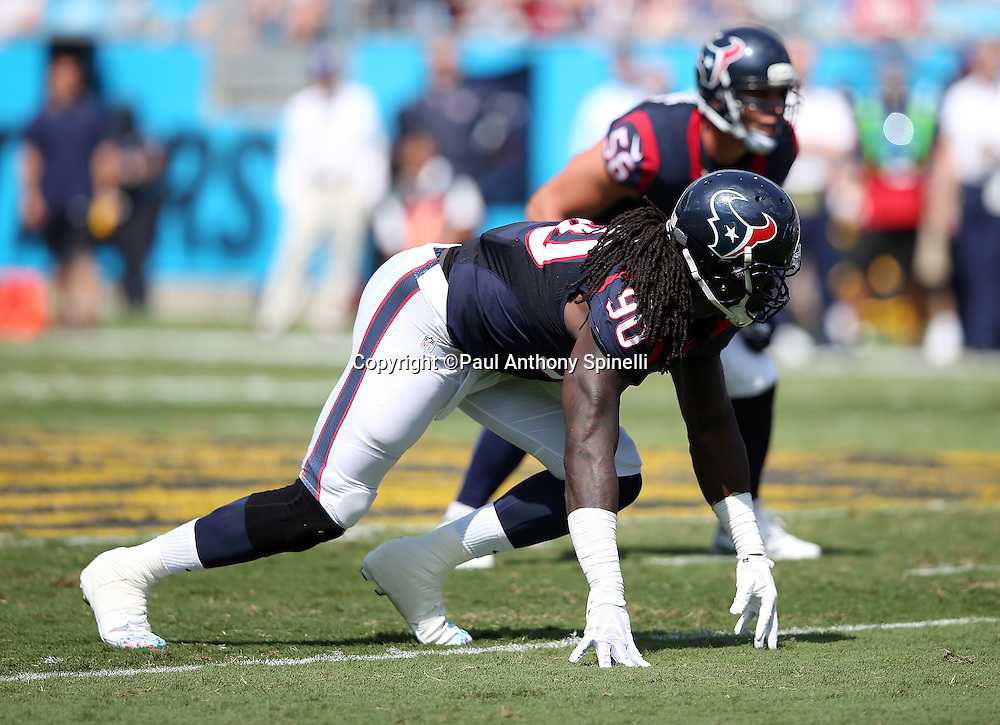Houston Texans outside linebacker Jadeveon Clowney (90) gets set in a four point stance at the line of scrimmage during the 2015 NFL week 2 regular season football game against the Carolina Panthers on Sunday, Sept. 20, 2015 in Charlotte, N.C. The Panthers won the game 24-17. (©Paul Anthony Spinelli)