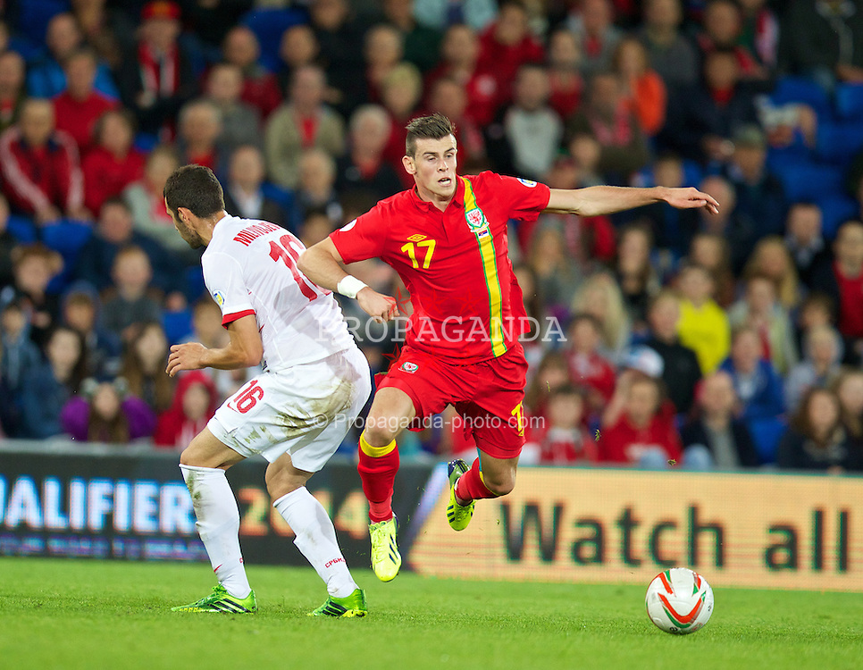 CARDIFF, WALES - Tuesday, September 10, 2013: Wales' Gareth Bale in action against Serbia's Srdan Mijailovic during the 2014 FIFA World Cup Brazil Qualifying Group A match at the Cardiff CIty Stadium. (Pic by David Rawcliffe/Propaganda)