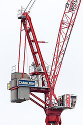 © Licensed to London News Pictures. 15/01/2018. London, UK. A crane operator from the construction firm Carillion leaves a crane in central London. Today, Carillion has gone into compulsory liquidation putting thousands of jobs at risk. Photo credit : Tom Nicholson/LNP