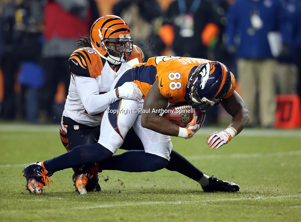 Denver Broncos wide receiver Demaryius Thomas (88) gets tackled by Cincinnati Bengals rookie cornerback Josh Shaw (26) after catching a third quarter pass during the 2015 NFL week 16 regular season football game against the Cincinnati Bengals on Monday, Dec. 28, 2015 in Denver. The Broncos won the game in overtime 20-17. (©Paul Anthony Spinelli)