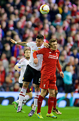 LIVERPOOL, ENGLAND - Thursday, March 10, 2016: Liverpool's Adam Lallana in action against Manchester United's Marcos Rojo during the UEFA Europa League Round of 16 1st Leg match at Anfield. (Pic by David Rawcliffe/Propaganda)