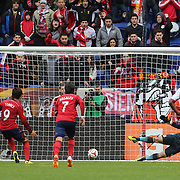 Erick Torres, Chivas USA, scores from the penalty spot beating New York Red Bulls keeper Luis Robles during the New York Red Bulls V Chivas USA, Major League Soccer regular season match at Red Bull Arena, Harrison, New Jersey. USA. 30th March 2014. Photo Tim Clayton