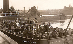 "© Licensed to London News Pictures. 30/09/2016. Birkenhead UK. Collect picture shows passengers on the Ralph Brocklebank (Daniel Adamson) in the 1920's. The Daniel Adamson steam boat has been bought back to operational service after a £5M restoration. The coal fired steam tug is the last surviving steam powered tug built on the Mersey and is believed to be the oldest operational Mersey built ship in the world. The ""Danny"" (originally named the Ralph Brocklebank) was built at Camel Laird ship yard in Birkenhead & launched in 1903. She worked the canal's & carried passengers across the Mersey & during WW1 had a stint working for the Royal Navy in Liverpool. The ""Danny"" was refitted in the 30's in an art deco style. Withdrawn from service in 1984 by 2014 she was due for scrapping until Mersey tug skipper Dan Cross bought her for £1 and the campaign to save her was underway. Photo credit: Andrew McCaren/LNP"