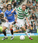 Scott Brown goes past Pedro Mendes during the League Cup final between Rangers and Celtic at Hampden Park -<br /> David Young