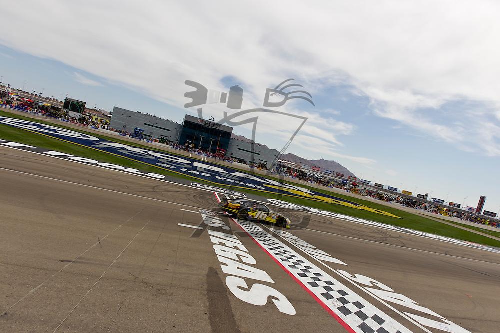 LAS VEGAS, NV - MAR 11, 2012:  Greg Biffle (16) crosses the finish line at the Kobalt Tools 400 NASCAR race in Las Vegas, NV.