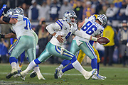 Jan 12, 2019; Los Angeles, CA, USA;  Dallas Cowboys quarterback Dak Prescott (4) attempts to handoff the ball against the Los Angeles Rams during an NFL divisional playoff game at the Los Angeles Coliseum. The Rams beat the Cowboys 30-22. (Kim Hukari/Image of Sport)