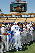 LOS ANGELES, CA - JUNE 30:  Bobby Abreu #23 of the Los Angeles Dodgers greets fans at fan photo day before the game against the New York Mets on Saturday, June 30, 2012 at Dodger Stadium in Los Angeles, California. The Mets won the game in a 5-0 shutout. (Photo by Paul Spinelli/MLB Photos via Getty Images) *** Local Caption *** Bobby Abreu