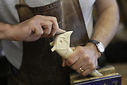Keith Pickering is polishing a hand-carved walking stick in his shop in Helmsley, Yorkshire, England, United Kingdom.