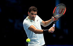 Grigor Dimitrov in action during singles match during day four of the NITTO ATP World Tour Finals at the O2 Arena, London.