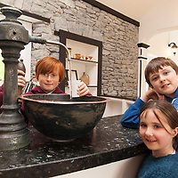 Paddy Haugh serving Spa Water to Katelynne and Graham Geraghty at the Opening of restored Spa Well in Lisdoonvarna