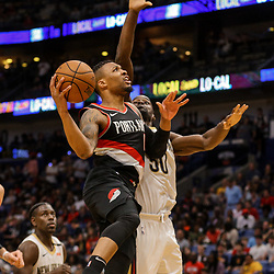 Mar 27, 2018; New Orleans, LA, USA; Portland Trail Blazers guard Damian Lillard (0) shoots over New Orleans Pelicans center Emeka Okafor (50) during the second half at the Smoothie King Center. The Trail Blazers defeated the Pelicans 107-103. Mandatory Credit: Derick E. Hingle-USA TODAY Sports