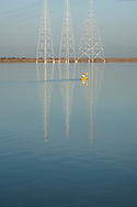 Kayaker in reflection of power lines, Redwood Creek, Redwood City, San Francisco Bay